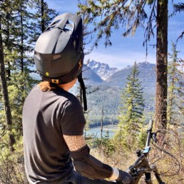 Mountain biker stops to look at mountain scenery