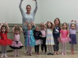 little girls at ballet class with teacher